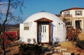 8 Companies That Are Revolutionizing Kit Homes - Photo 5 of 9 - Designed for the homeless and displaced, InterShelter domes are frameless structures made of high-tech aerospace composite material, providing strength and durability while allowing the structures to be easily disassembled and relocated. The materials for these domes can fit in the back of a truck, and are easily assembled in under four hours by two people. Once assembled, the structures are watertight, hurricane proof, and earthquake proof. They can even be combined into multi-structures, providing almost limitless possibilities as to size and design.